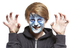 Teenage boy with face painting wolf. Growling on white background Royalty Free Stock Photography