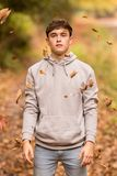 Teenage boy and falling leaves royalty free stock images