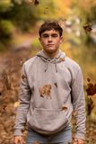 Teenage boy and falling leaves stock photography