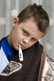 Teenage boy feeling ill Royalty Free Stock Photography