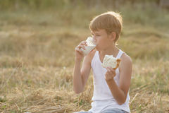 Teenage boy during field picnic Royalty Free Stock Images