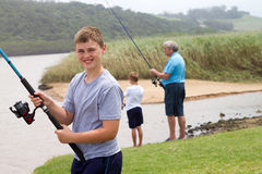 Teenage boy fishing stock photo