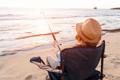 Teenage boy fishing at sea Stock Photography