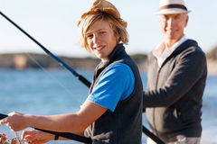 Teenage boy fishing at sea royalty free stock images