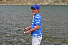 Teenage boy fishing Royalty Free Stock Image