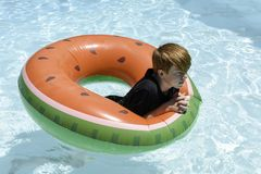 Teenage boy in floatie royalty free stock photos