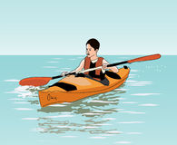 Teenage boy floats on kayak Royalty Free Stock Images