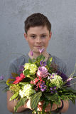 Teenage boy with flower bouquet Stock Photo