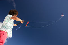 Teenage boy flying a kite Stock Image