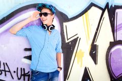 Teenage boy in front of graffiti Stock Photo