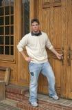 Teenage boy in front of oak doors Stock Photography