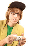 Teenage boy with game controller. Teenage boy in glasses holding electronic game controller royalty free stock photo