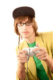 Teenage boy with game controller. Teenage boy in glasses holding electronic game controller stock photo