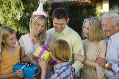 Teenage Boy Gifting Mother Royalty Free Stock Image