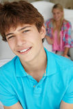 Teenage boy and girl in bedroom together Royalty Free Stock Image