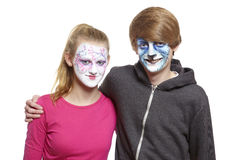 Teenage boy and girl with face painting geisha girl and wolf Royalty Free Stock Image