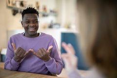 Teenage Boy And Girl Having Conversation Using Sign Language. Teenage Boy And Girl Have Conversation Using Sign Language stock photography