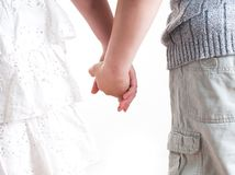 Teenage boy and girl holding hands. Royalty Free Stock Image