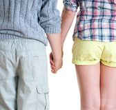 Teenage boy and girl holding hands. stock image