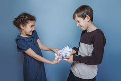 Teenage boy and girl holding money bills in his Stock Photography
