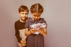 Teenage boy and girl  holding  money bills in his Stock Image