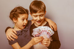 Teenage boy and girl holding money bills  Stock Image