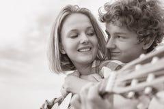 Teenage boy and girl  play guitar Royalty Free Stock Photo