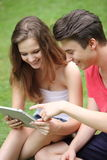 Teenage boy and girl using a tablet-pc Stock Photo