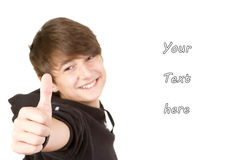 Teenage boy gives thumbs up sign Stock Image