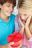 Teenage boy giving gift to girl Royalty Free Stock Images
