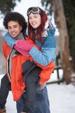 Teenage Boy Giving Girl Piggyback Stock Image