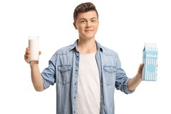 Teenage boy with a glass of milk and a milk carton Royalty Free Stock Photos