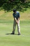Teenage Boy Golfing stock image