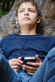 Teenage boy with GPS Stock Photography