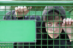 Teenage boy in a green cage Royalty Free Stock Images