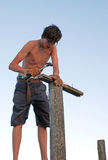 Teenage Boy with Hammer Royalty Free Stock Images