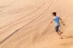 Teenage boy having fun at desert Stock Photos