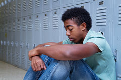 Teenage boy having problems at school Stock Image