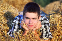 Teenage Boy in the Hay close-up Royalty Free Stock Photos