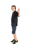 Teenage boy with headphones showing sign Ok Royalty Free Stock Image