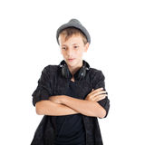 Teenage boy with headphones wearing a hat. Stock Images