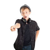 Teenage boy with headphones wearing a hat, surprising face. Stock Photos