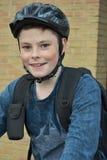 Teenage boy with helmet. Teenage boy with hard helmet and backpack Royalty Free Stock Image