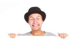 Teenage boy hiding behind a billboard Royalty Free Stock Photography