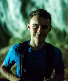 Teenage boy hiker in a cave, closeup Royalty Free Stock Images