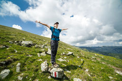 Teenage boy hiker on the mountains Stock Photo