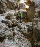 Teenage boy hiking on a rocky mountains Royalty Free Stock Photo