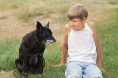 Teenage boy and his animal friend Stock Photo