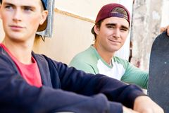 Teenage boys sitting at the street Royalty Free Stock Images