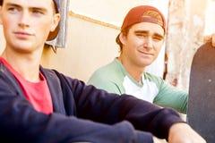 Teenage boys sitting at the street Stock Image